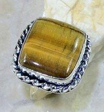 טבעת כסף בשיבוץ אבן טייגר אי זהב מידה: 9.75