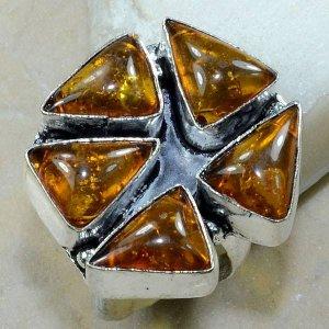 טבעת כסף משובצת ענבר מידה : 7.75