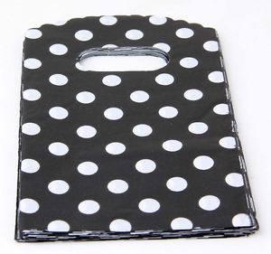 """50 שקיות אריזה עם ידית עיצוב עגולים שחור לבן מידה: 9*15 ס""""מ"""