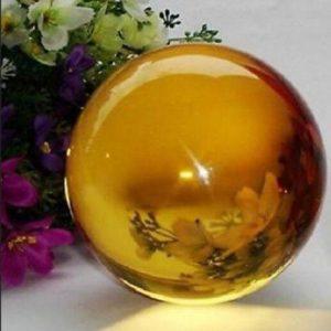 """כדור אובסידיאן צהוב + מעמד עץ קוטר: 40 מ""""מ"""