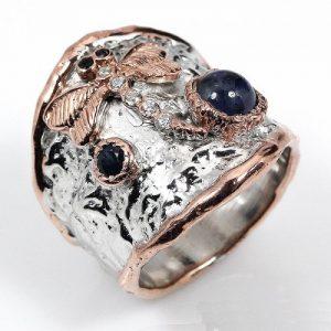טבעת עבודת יד בשיבוץ ספיר וטופז כסף וציפוי זהב