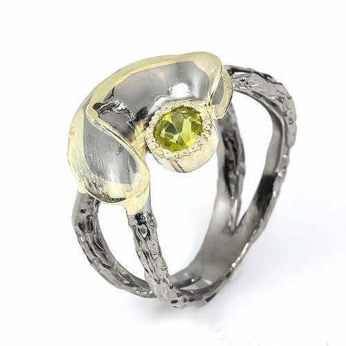 טבעת עבודת יד בשיבוץ פרידות כסף,ציפוי זהב ורודיום שחור