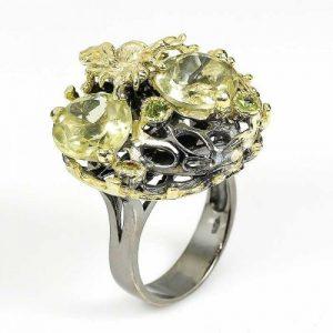טבעת עבודת יד בשיבוץ קוורץ לימון ופרידות כסף ציפוי זהב ורודיום שחור