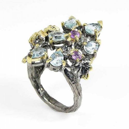 טבעת עבודת יד בשיבוץ אבני טופז כחול ואמטיסט כסף ציפוי זהב ורודיום שחור