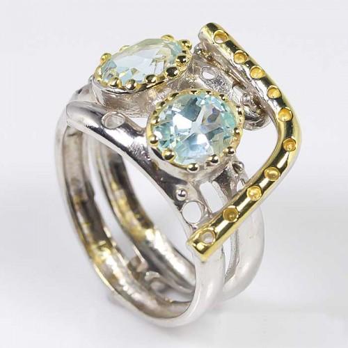 טבעת עבודת יד בשיבוץ אבני טופל כחול כסף וציפוי זהב