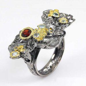טבעת עבודת יד בשיבוץ אבני גרנט וטופז כחול כסף ציפוי זהב ורודיום שחור