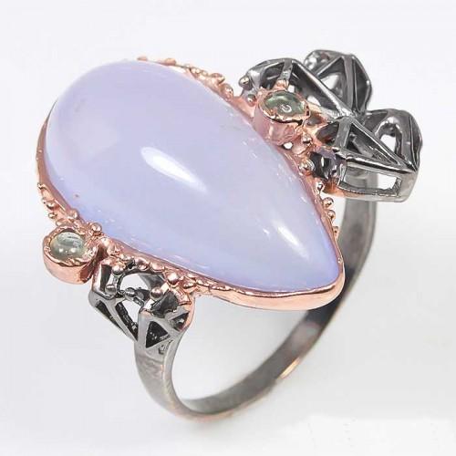 טבעת עבודת יד בשיבוץ אבני קלצדוני וספיר כסף ציפוי בהב ורודיום שחור