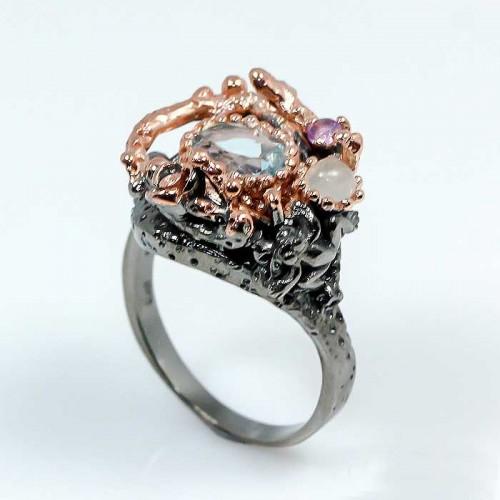טבעת בשיבוץ אבני טופז אמטיסט ומונסטון