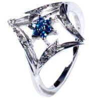 טבעת כסף בשיבוץ יהלומי גלם 0.46 קרט וזירקון כחול מידה: 7