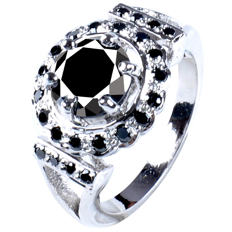 טבעת כסף בשיבוץ אבני מואסנייט הטבעת: 4.55 קרט מידה: 8
