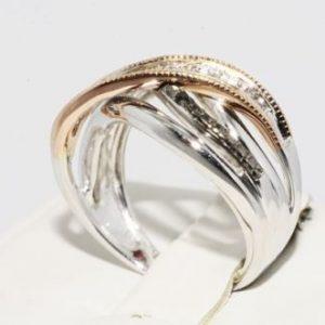 טבעת כסף וזהב אדום בשיבוץ יהלומים ניקיון: s12 מידה: 7