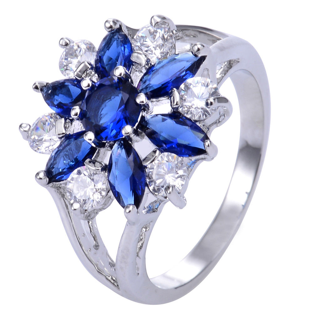 טבעת כסף בשיבוץ ספיר כחול וטופז לבן מידה: 8 הטבעת: 4.8 גרם