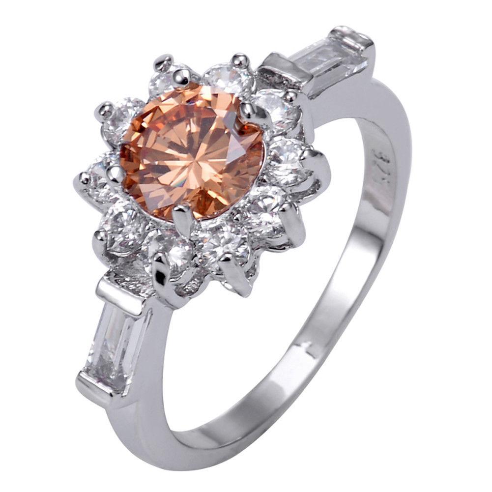 טבעת כסף בשיבוץ טופז כתום ולבן מידה: 9 הטבעת: 3.8 גרם