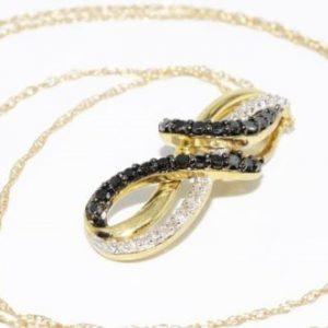 תליון ושרשרת זהב צהוב בשיבוץ יהלומים שחורים ולבנים 45. קרט