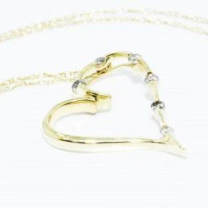 שרשרת ותליון זהב צהוב עיצוב לב בשיבוץ 6 יהלומים 10. קרט
