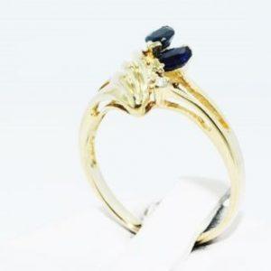 טבעת זהב צהוב בשיבוץ ספיר כחול ויהלומים 36. קרט ניקיון יהלום: I1 מידה: 5.5
