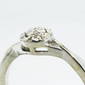 טבעת כסף בשיבוץ יהלומים לבנים 08. קרט ניקיון יהלומים: I1 מידה: 7