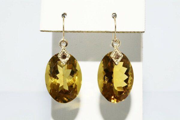 עגילי זהב צהוב 14 קרט בשיבוץ סיטרין 24 קרט בשיבוץ 2 יהלומים 08. קרט ניקיון יהלומים: VS2