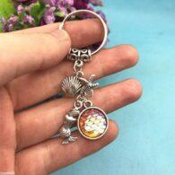 מחזיק מפתחות סמלי בת הים גווני כתום
