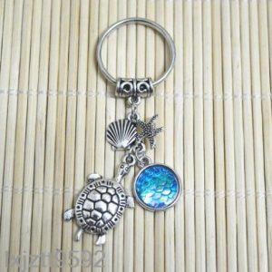 מחזיק מפתחות צב צדף וכוכב ים גווני כחול ירקרק